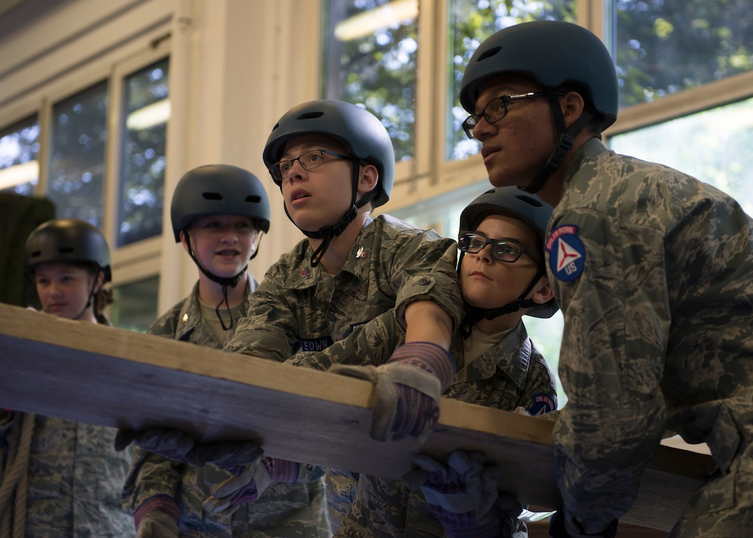 U.S. Civil Air Patrol cadets work together to balance a plank of wood during a team-building activity August 1, 2019, at Kapaun Air Station, Germany. The 2019 European Summer Encampment is the largest overseas encampment held so far, hosting cadet Airmen from states such as Alaska to countries such as the United Kingdom.
