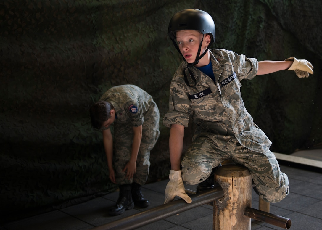U.S. Civil Air Patrol tests his balance during a team-building activity August 1, 2019, at Kapaun Air Station, Germany. Cadet Airmen spent July 26 to August 2 learning about the operations of the U.S. Air Force during the 2019 European Summer Encampment.