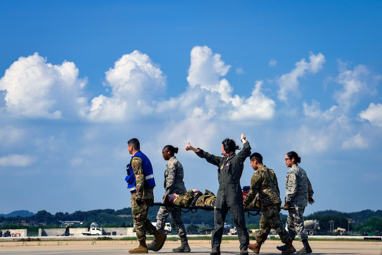 Airmen from the 51st Medical Group advance the flightline to transport a soldier from Camp Zama, Japan during Operation Ascending Eagle, Aug. 28, 2019, at Osan Air Base, Republic of Korea. Air Force and Army medics jointly operated in the simulated large casualty training to enhance their aeromedical evacuation and patient transportation procedures. (U.S. Air Force photo by Staff Sgt. Greg Nash)