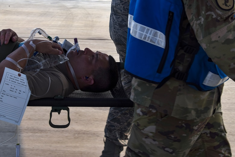 An injured Army patient awaits to be transported onto a C-130J Super Hercules during Operation Ascending Eagle, Aug. 28, 2019, at Osan Air Base, Republic of Korea. Air Force and Army medics jointly operated in the simulated large casualty training to enhance their aeromedical evacuation and patient transportation procedures. (U.S. Air Force photo by Staff Sgt. Greg Nash)