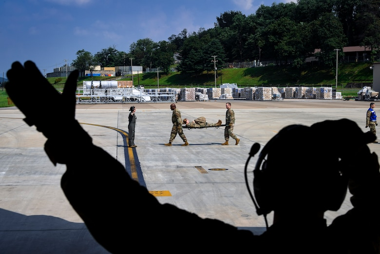 Airmen from the 51st Medical Group carry an injured soldier during Operation Ascending Eagle, Aug. 28, 2019, at Osan Air Base, Republic of Korea. Air Force and Army medics jointly operated in the simulated large casualty training to enhance their aeromedical evacuation and patient transportation procedures. (U.S. Air Force photo by Staff Sgt. Greg Nash)