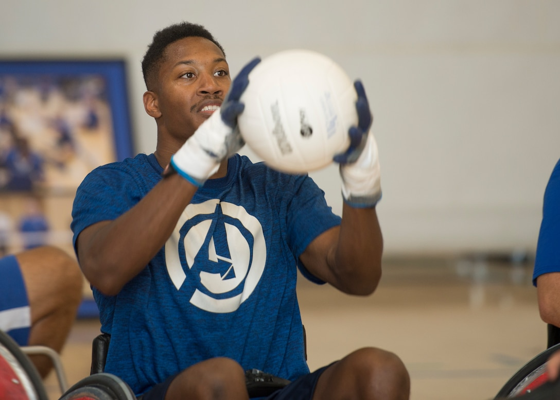 U.S. Air Force Senior Airman John Berry, Wounded Warrior ambassador, catches the ball in a game of wheelchair rugby July 22, 2019 at Ramstein Air Base, Germany. Berry has been a member of Air Force Wounded Warrior for two years.