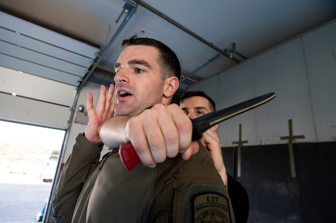 "U.S. Air Force 1st Lt. Stephen Cromp, 569th U.S. Forces Police Squadron operations officer and Emergency Services Team leader, demonstrates an escape move against U.S. Air Force Staff Sgt. Brock Miller, 569th USFPS desk sergeant and EST team member, during a counter-knife training at Kapaun Air Station, Germany, Sept. 4, 2019. During the training members used ""shock knives,"" a blunt-edge weapon featuring a battery powered electrical blade which delivers a small shock when pressed against skin. (U.S. Air Force photo by Staff Sgt. Jonathan Bass)"