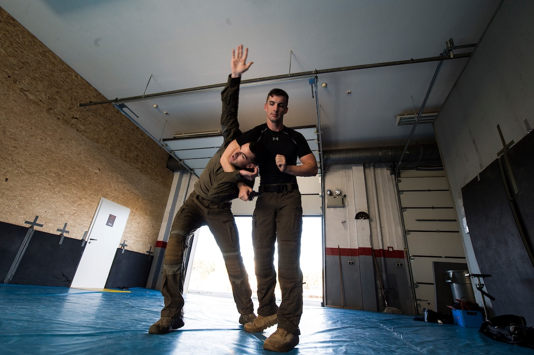 U.S. Air Force 1st Lt. Stephen Cromp, 569th U.S. Forces Police Squadron operations officer and Emergency Services Team leader, demonstrates an escape move against U.S. Air Force Staff Sgt. Brock Miller, 569th USFPS desk sergeant and EST team member, during a counter-knife training at Kapaun Air Station, Germany, Sept. 4, 2019. During the training, Cromp demonstrated a number of counter maneuvers designed to work against an adversary wielding a knife. (U.S. Air Force photo by Staff Sgt. Jonathan Bass)