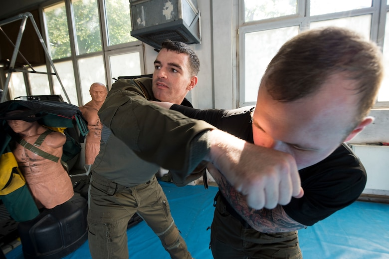 U.S. Air Force 1st Lt. Stephen Cromp, 569th U.S. Forces Police Squadron operations officer and Emergency Services Team leader, demonstrates an escape move against U.S. Air Force Staff Sgt. Robert Harris, 569th USFPS unit training instructor and EST member during a counter-knife training at Kapaun Air Station, Germany, Sept. 4, 2019. Cromp, a Boston, Massachusetts, native, taught a mix of Air Force combatives, common law enforcement takedowns, Krav Maga, and mixed martial arts on each other during the training. (U.S. Air Force photo by Staff Sgt. Jonathan Bass)