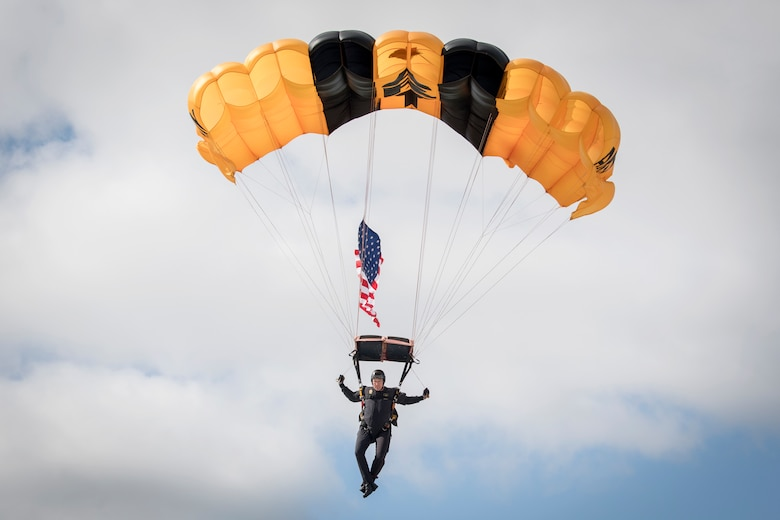 Sgt. 1st Class Derrick Coleman, U.S. Army Golden Knights parachute team member, lands during a demonstration at  Grissom Air & Space Expo, Grissom Air Reserve Base, Indiana Sept. 7, 2019. The Golden Knights kicked off the event with the American flag and the National Anthem. (U.S. Air Force photo/Master Sgt. Benjamin Mota)
