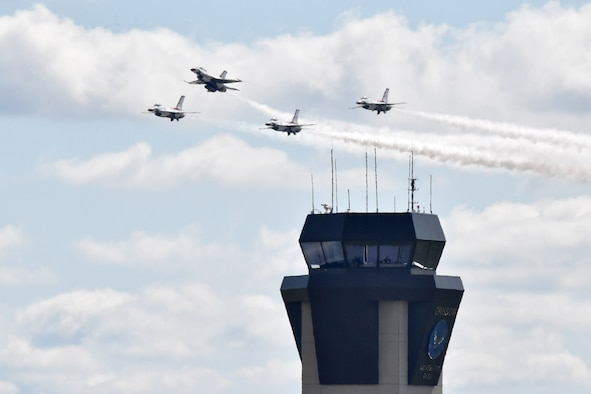 The U.S. Air Force Thunderbirds fly past Grissom's air traffic control tower during the Grissom Air & Space Expo, Sept. 7, 2019. The two-day event drew a crowd of more than 50,000 spectators and was the first airshow the base has held since 2003. (U.S. Air Force photo/Tech. Sgt. Jami Lancette)