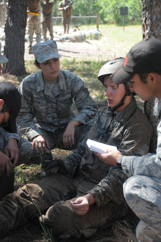 Senior Airman Alissa Toca (far left),a 445th Aeromedical Staging Squadron aerospace medical technician, provides technical supervision and support to U.S. Air Force Academy cadets during a field training event at the Air Force Academy, Colorado Springs, July 23, 2019.