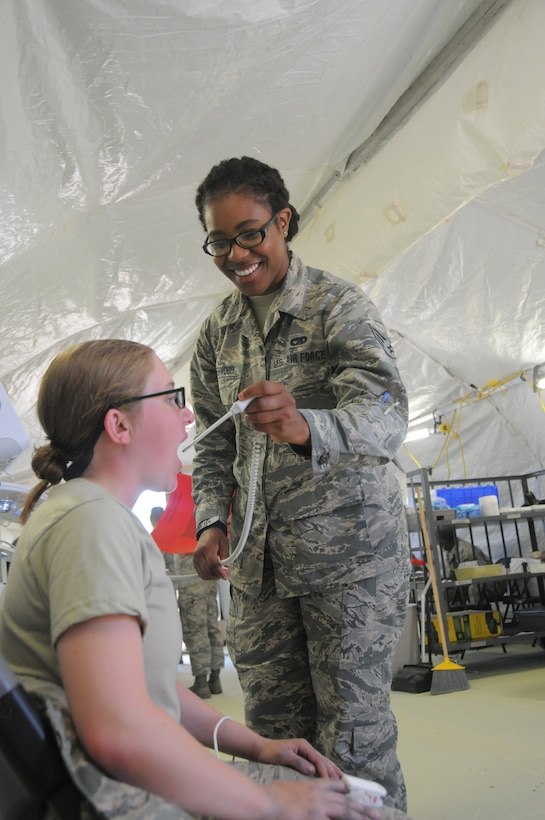 Senior Airman Latrice Greenwood, 445th Aeromedical Staging Squadron aerospace medical technician, checks and records the vital signs of a U.S. Air Force Academy cadet inside the medical triage tent at the Air Force Academy, Colorado Springs, July 23, 2019