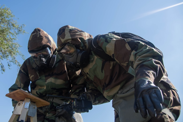 Airman 1st Class Shaquayla Jackson, 22nd Force Support Squadron force management technician, and Airman 1st Class Emanuel Perez, 22nd Aircraft Maintenance Squadron crew chief, participate in Post Attack Reconnaissance procedures by checking chemical agent detection paper for chemical agents Sept. 5, 2019, at McConnell Air Force Base, Kan. PAR teams were instructed to look for unexploded ordnance in the surrounding area for chemical agents during their chemical, biological, radiological and nuclear defense training. (U.S. Air Force photo by Airman 1st Class Marc A. Garcia)