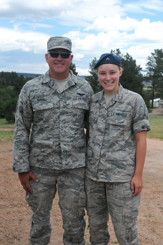 Cadet 3rd Class Kaura Gornall is currently a junior at the U.S. Air Force Academy, poses with her father, Senior Master Sgt. John Gornall, a medical technician with the 445th Aeromedical Staging Squadron. Senior Master Sgt. Gornall was happy to be able to complete his annual tour at the Air Force Academy in Colorado Springs where he could see Kaura in action.