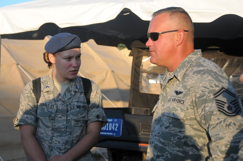 Cadet 3rd Class Kaura Gornall, U.S. Air Force Academy junior, interacts with her father, Senior Master Sgt. John Gornall, a medical technician with the 445th Aeromedical Staging Squadron, July 29, 2019 at the Academy.