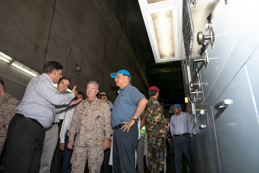 A representative of the Water and Power Development Authority, far left, speaks with U.S. Marine Corps Gen. Kenneth F. McKenzie, center, the commander of U.S. Central Command, at the Tarbela Dam hydroelectric plant in the Khyber Pakhtunkwa Province, Pakistan, Sept. 7, 2019. (U.S. Marine Corps photo by Sgt. Roderick Jacquote)