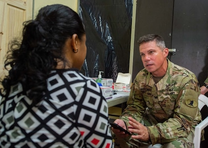 A U.S. Army doctor speaks to a patient.