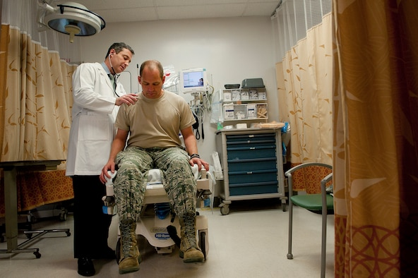Sean Harap, Tripler Army Medical Center physician, performs a physical exam for U.S. Air Force Capt. Joshua Gscheidmeier, 128th Air Refueling Wing, at Tripler Army Medical Center, Honolulu, Hawaii, May 8, 2014. The Nurse Advice Line is set to offer TRICARE beneficiaries an alternative to getting medical care starting May 30. The advice line is designed to offer patients a way to receive medical assessment, information, direction and care before choosing whether or not visiting an emergency room is necessary. (U.S. Air Force photo by Staff Sgt. Christopher Hubenthal)