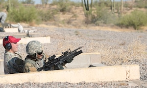 Staff Sgt. Treveyon Young, 56th Security Forces Squadron flight sergeant, fires a round from his M203 grenade launcher Sept. 4, 2019, at the Arizona Army National Guard range in Florence, Ariz.