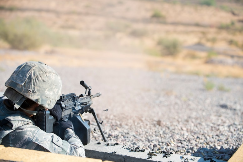 Airman 1st Class Ruth Salgado, 56th Security Forces Squadron installation entry controller, fires rounds from a M249 squad automatic weapon Sept. 4, 2019, at the Arizona Army National Guard range in Florence, Ariz.