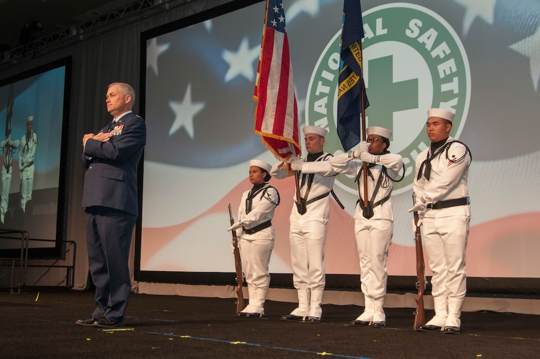 Col. William Culver, Air Force Safety Center's deputy commander, stands ready to present a flag to 9/11 survivor during the opening ceremonies of the National Safety Council's 2019 Congress & Expo held in San Diego, California, Sept. 6-11.