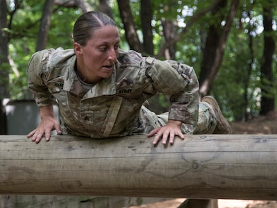 Sgt. Danielle Martin negotiates an obstacle during the 1-134th Cavalry Squadron's spur ride during annual training in the Republic of Korea June 17, 2019.