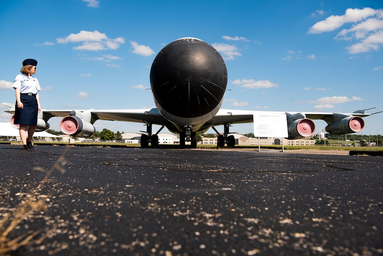 Airman 1st Class Brittany Parsons, 90th Comptroller Squadron financial operations technician, looks back on the EC-135E ARIA (Boeing) during a tour of the air park at National Museum of the U.S. Air Force Sept. 4, 2019, at Wright-Patterson Air Force Base, Ohio. A group of Airmen from F.E. Warren Air Force Base, Wyo., took a heritage trip to the museum to learn about teamwork throughout ICBM history. (U.S. Air Force photo by Senior Airman Abbigayle Williams