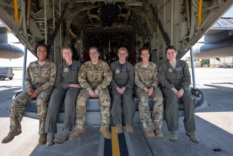 Airmen with the 347th Rescue Group pose for a photo after completing the HC-130J Combat King II's first flight to be operated by an all-female aircrew Sept. 6, 2019, at Moody Air Force Base, Ga. From left to right: Airman 1st Class Jazmyne Lomax, Capt. Sarah Edwards, Senior Airman Rachel Bissonnette, Capt. Leslie Weisz, Tech. Sgt. Colleen McGahuey-Ramsey, and Capt. Jordan Barden. (U.S. Air Force photo by 2nd Lt. Kaylin P. Hankerson