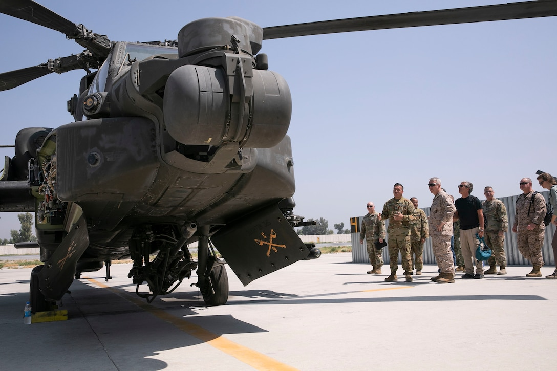 Personnel from Train Advise Assist Command – East show U.S. Marine Corps Gen. Kenneth F. McKenzie, the commander of U.S. Central Command, an AH-64 Apache helicopter at Jalalabad Airfield, Afghanistan, Sept. 9, 2019. (U.S. Marine Corps photo by Sgt. Roderick Jacquote)