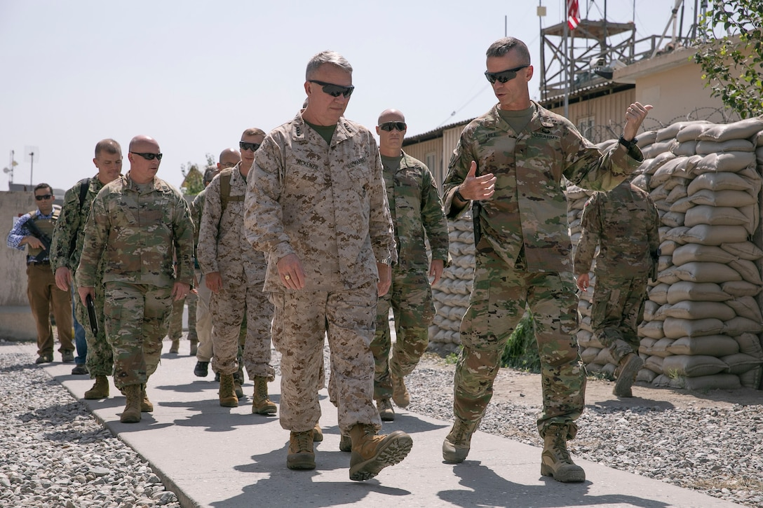 U.S. Army Brig. Gen. Donn H. Hill, front right, the commander of Train Advise Assist Command – East, speaks with U.S. Marine Corps Gen. Kenneth F. McKenzie, front left, the commander of U.S. Central Command, during McKenzie's visit in Jalalabad, Afghanistan, Sept. 9, 2019. (U.S. Marine Corps photo by Sgt. Roderick Jacquote)