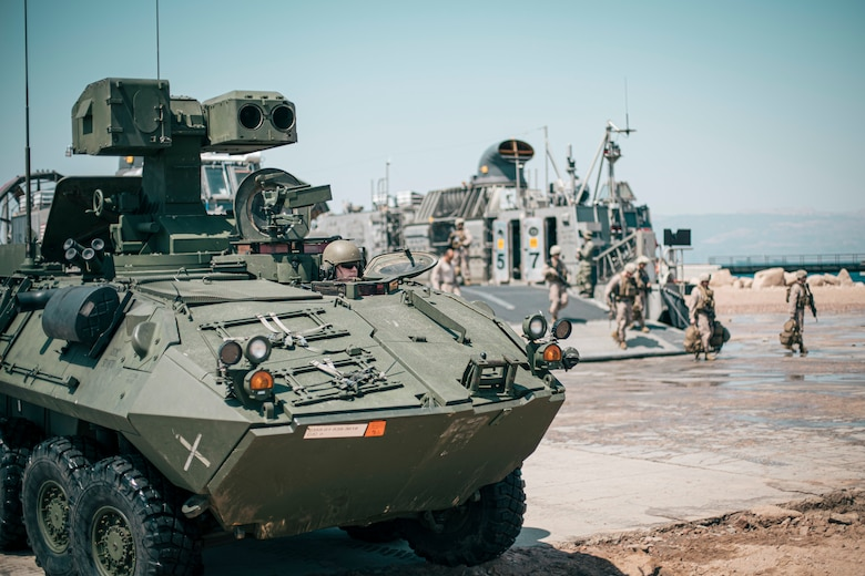 A U.S. Marine drives a light armored vehicle off of a landing craft, air cushion after coming ashore at Aqaba, Jordan, in support of exercise Eager Lion 2019, Aug. 31.