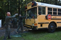 Savannah Police Department SWAT members perform tactical response training at the 165th Airlift Wing, Savannah, Ga., Aug. 22, 2019. The scenarios were facilitated by the FBI to incorporate training with local entities, such as Savannah PD and the 165th Airlift Wing in the event of an integrated response effort. (U.S. Air National Guard photo by Amber Williams)