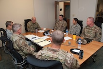 Senior leaders of the 165th Airlift Wing gather to account for personnel and military assets during a morning briefing at the Savannah Air National Guard Base, Ga. Sept. 4, 2019. Mission essential personnel are sustaining 24-hour operations to protect military assets and ensure personnel are evacuated ahead of Hurricane Dorian. In the storm's aftermath, Airmen of the 165th Airlift Wing are prepared to assist local and state authorities, and their residents, as they are affected by Hurricane Dorian.