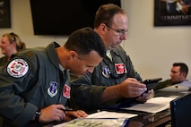 U.S. Air Force Lieutenant Col. John Mims, 158th Airlift Squadron director of operations, and Major Mantis Pineiro, a 158th Airlift Squadron C-130 pilot, review operational plans for the return of assets on Sept. 7, 2019. This C-130 is scheduled to carry military members to Dobbins Air Reserve Base following aircraft relocation during Hurricane Dorian. (U.S. Air Force photo by Senior Airman Renee Crugnale)