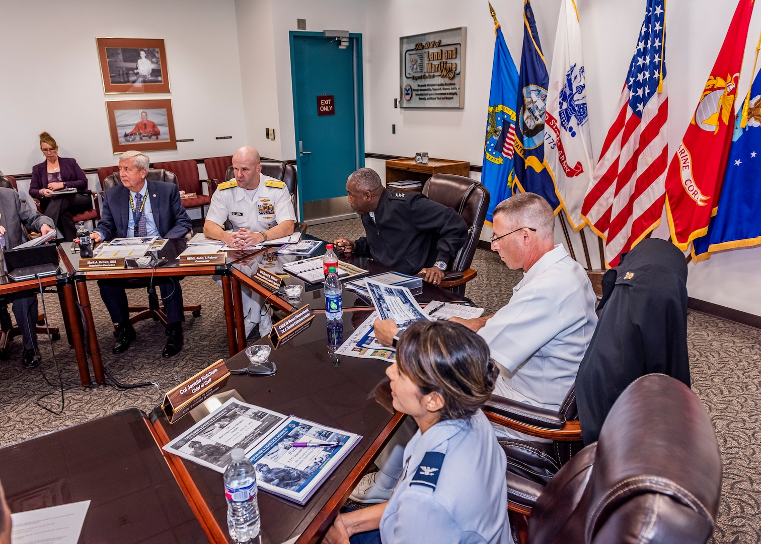 Lt. Gen. Darrell Williams sits at a table with leadership