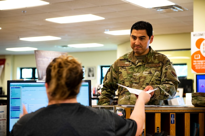 Master Sgt. Brian Sanchez, right, 23d Medical Support Squadron laboratory and diagnostic imaging flight chief, gets assistance from Katrina True, 23d Force Support Squadron library aid, Sept. 5, 2019, at Moody Air Force Base, Ga. The Information Learning Center serves as the central hub for all informational and educational growth for Airmen and their families here. (U.S. Air Force photo by Senior Airman Erick Requadt)