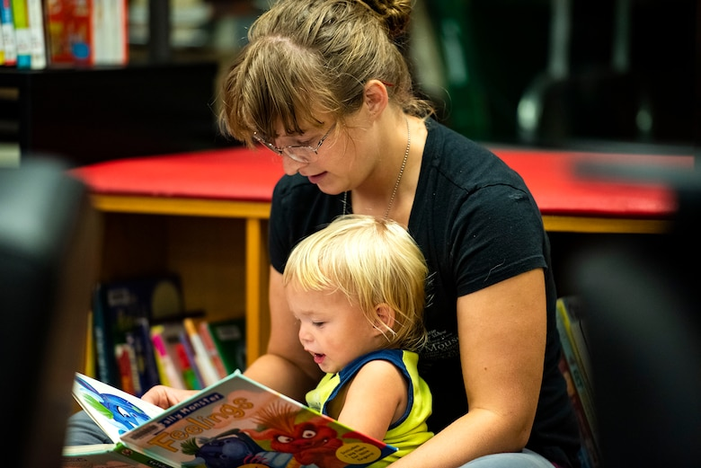 Megan Thorne, military spouse, reads to her son, Layton, Sept. 5, 2019, at Moody Air Force Base, Ga. The Information Learning Center provides a means of morale and serves as the central hub for all informational and educational growth for Airmen and families. (U.S. Air Force photo by Senior Airman Erick Requadt)