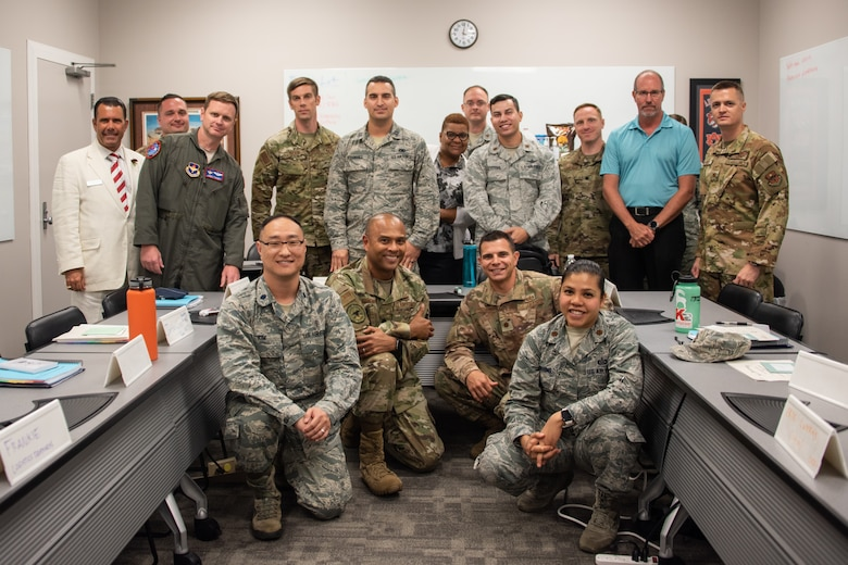 Graduates of Air University's Leadership Development Course for Squadron Command pose for a group photo, Aug. 29, 2019, on Maxwell Air Force Base, Alabama. Maj. Richard Mottinelli, LDC graduate, said that having the perspective and mentorship from retired commanders and academic scholars helped give the students insight into leadership qualities, personality traits and communication tools that they haven't gotten before from other professional military education courses.