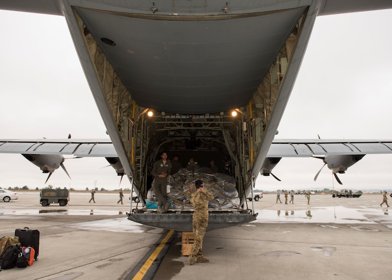 A C-130 Hercules crew from Little Rock Air Force Base, Arkansas, prepares to unload cargo at the start of Air Mobility Command's Mobility Guardian 2019 exercise at Fairchild Air Force Base, Washington, Sept. 8, 2019. Through robust and relevant training, Mobility Guardian is designed to build full spectrum readiness and develop Air Mobility Airmen to ensure we deliver rapid global mobility now and in the future. (U.S. Air Force photo by Senior Airman Ryan Lackey)
