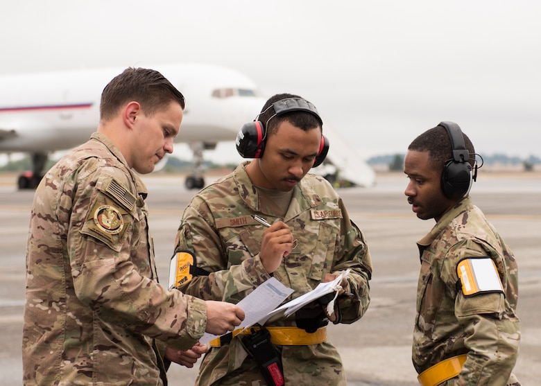 Logistics Airmen from the 43rd Air Mobility Operations Group, Pope Army Airfield, North Carolina, compare cargo manifests on the first day of Air Mobility Command's Mobility Guardian 2019 exercise at Fairchild Air Force Base, Washington, Sept. 8, 2019. Exercise Mobility Guardian is AMCs premier, large-scale mobility exercise during which more than 2,500 Air Mobility Airmen will participate. (U.S. Air Force photo by Senior Airman Ryan Lackey) (Badge details removed in post-processing for operational safety and security)