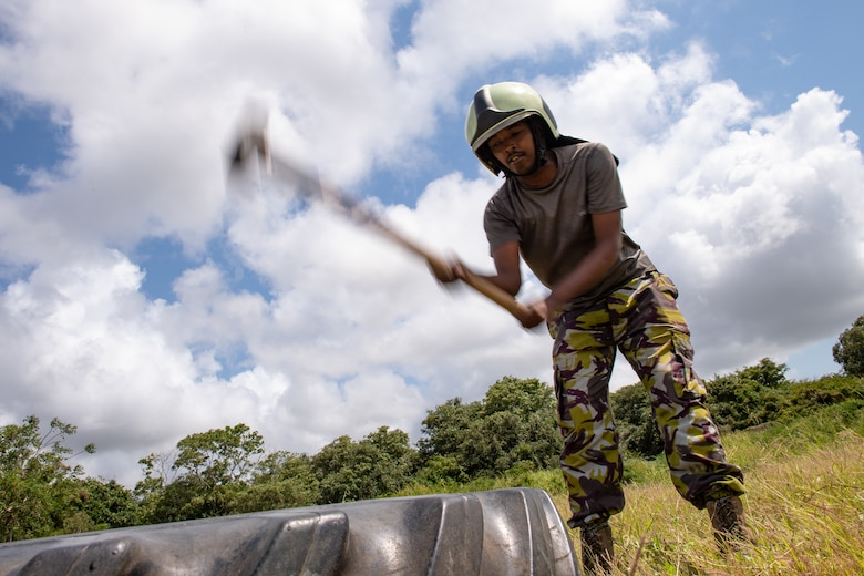 A Kenya Navy firefighter swings a hammer during a training circuit at Manda Bay, Kenya, Aug. 29, 2019. The training, held by 475th Expeditionary Air Base Squadron firefighters, was designed to build upon the established partnership between the two nations by enforcing teamwork and endurance while enhancing technical proficiency. (U.S. Air Force photo by Staff Sgt. Devin Boyer)