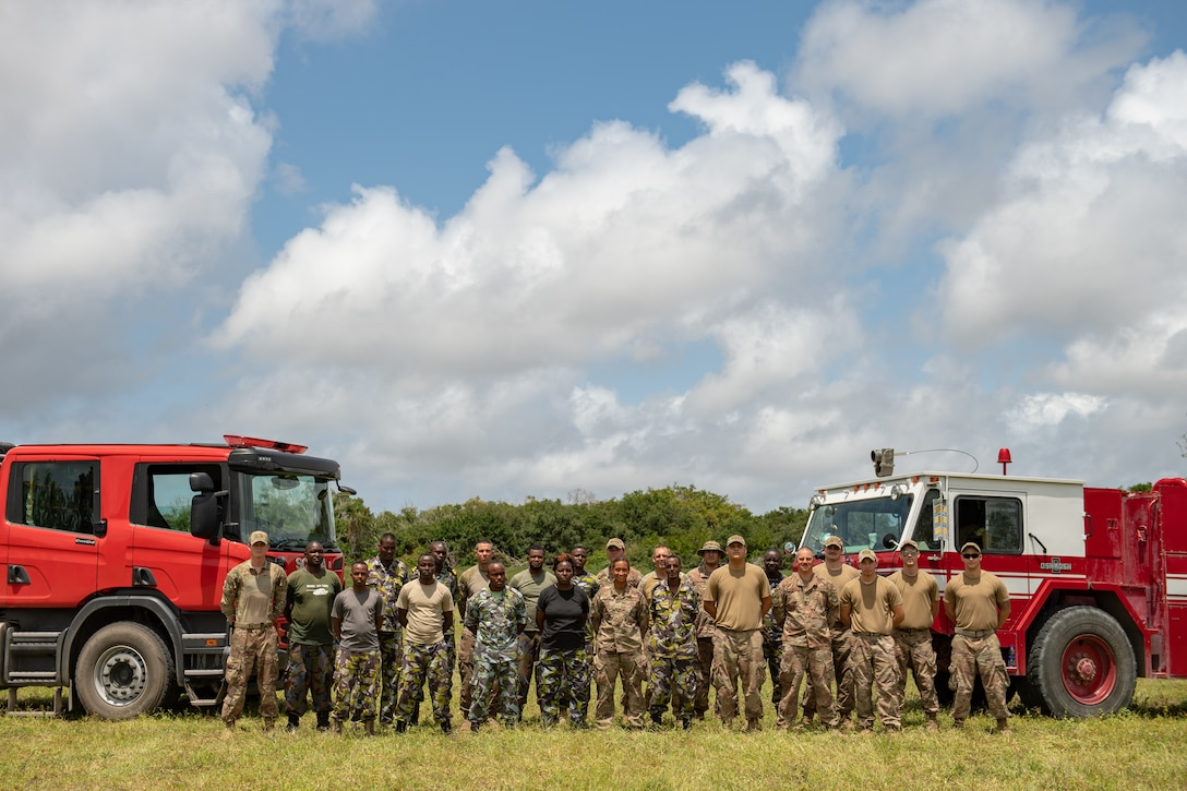 U.S. Air Force firefighters assigned to the 475th Expeditionary Air Base Squadron, and Kenya Navy firefighters pose for a group photo at Manda Bay, Kenya, Aug. 29, 2019. The 475th EABS firefighters hosted training designed to build upon the established partnership between the two nations by enforcing teamwork and endurance while enhancing technical proficiency. (U.S. Air Force photo by Staff Sgt. Devin Boyer)