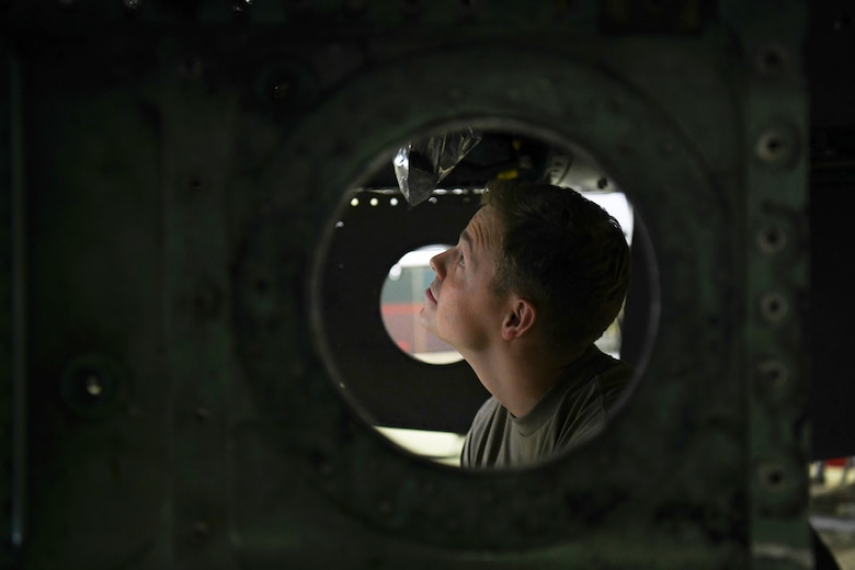 "A crew chief assigned to the 48th Equipment Maintenance Squadron inspects an F-15 during a phase inspection at Royal Air Force Lakenheath, England, Aug. 13, 2019. The 48th EMS recently won the Innovation and Transformation Council award for developing and implementing a training and inspection readiness tool called ""The Bird Book"". (U.S. Air Force photo by Airman 1st Class Shanice Williams-Jones)"