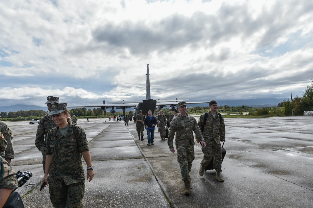 U.S. service members and members of the Armed Forces Bosnia-Herzegovina exit the flightline Sept. 9, 2019, after a C-130H Hercules aircraft assigned to the 179th Airlift Wing, Ohio Air National Guard, lands at Tuzla International Airport, Bosnia-Herzegovina, as part of the Silver Arrow training event.