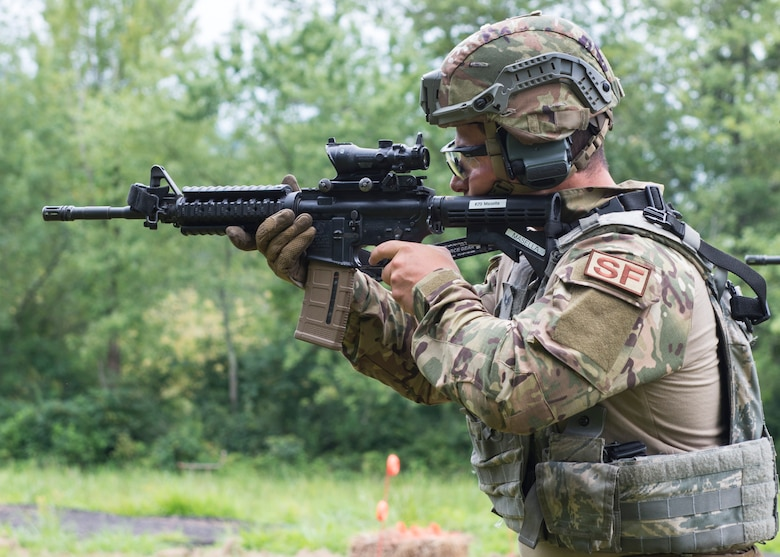 Senior Airman Emilio Masella, 103rd Security Forces Squadron, aims at a target during a range event at the Connecticut SWAT Challenge in Simsbury, Conn. Aug. 14, 2019. The competition brings together tactical operators from across the nation and beyond to practice SWAT weapons tactics, movements and physical fitness. (U.S. Air National Guard photo by Staff Sgt. Steven Tucker)