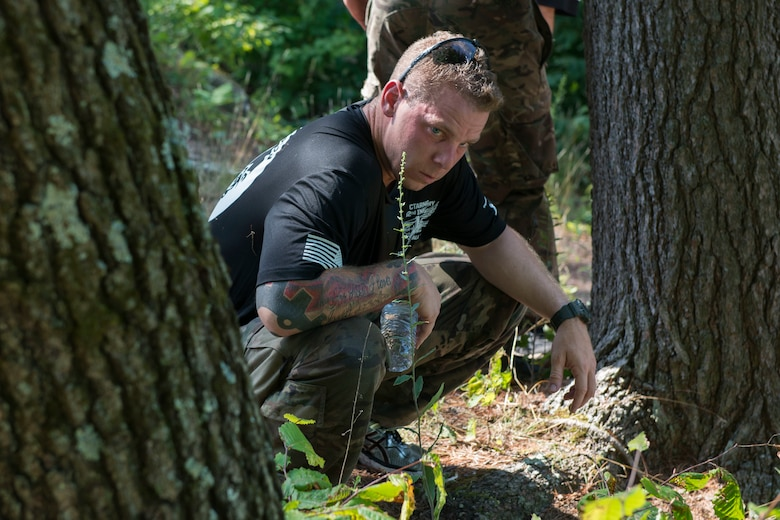 A Connecticut National Guardsman assigned to the 1-102nd Infantry Regiment performs a food eating challenge during the physical training portion of the 15th Annual Connecticut SWAT Challenge in West Hartford, Conn., August 15, 2019. The Connecticut SWAT Challenge is a competition that tests the tactical skills of law enforcement officers. (Air National Guard photo by Tech. Sgt. Tamara R. Dabney)