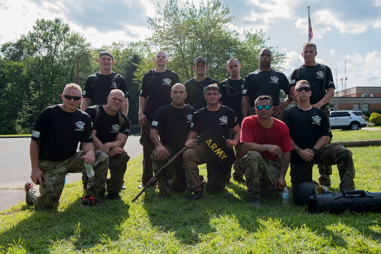 Connecticut National Guardsmen assigned to the 1-102nd Infantry Regiment pose for a photo after competing in the 15th Annual Connecticut SWAT Challenge in West Hartford, Conn., August 15, 2019. The Connecticut SWAT Challenge is a competition that tests the tactical skills of law enforcement officers. (Air National Guard photo by Tech. Sgt. Tamara R. Dabney)