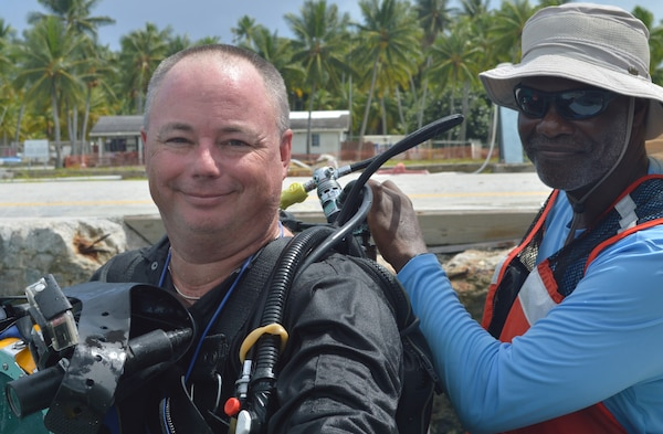 Darryl Bishop (right) and Steve England (left) serve on the USACE Forward Response Technical Dive Team. The team conducted above and below water inspections of waterfront infrastructure from Aug. 13-26, 2019 at the U.S. Army Garrison Kwajalein Atoll in the Republic of the Marshall Islands. The dive team performs underwater inspections around the world on behalf of the Army's Installation Management Command.