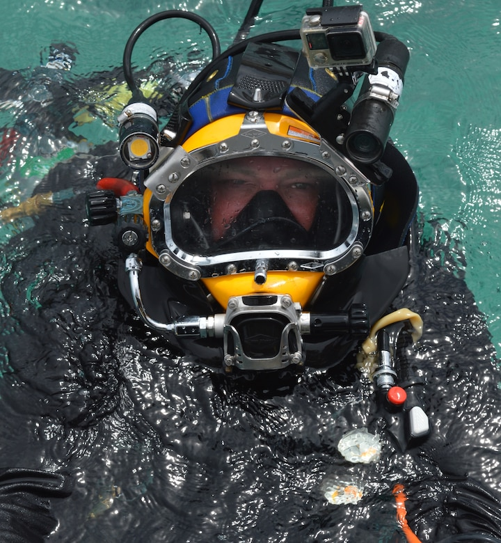 Steve England emerges after a dive during inspections at the  U.S. Army Garrison Kwajalein Atoll. England is a hydraulic engineer for the USACE Philadelphia District and serves on the USACE Forward Response Technical Dive Team. The dive team performs underwater inspections around the world on behalf of the Army's Installation Management Command.