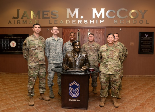 The James M. McCoy Airman Leadership School commandant and instructors pose for a photo after receiving the 2018 ALS of the Year award at Offutt Air Force Base, Nebraska Sept. 5, 2019. The primary mission of ALS is to prepare senior airmen for supervisory duties and leadership roles in supporting the employment of air, space and cyberspace capabilities as NCOs. (U.S. Air Force photo by Charles J. Haymond)