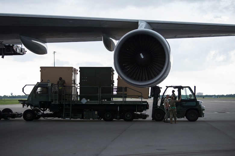 Members of the 6th Logistics Readiness Squadron (LRS) remove cargo from a Boeing 747 aircraft during a cargo movement at MacDill Air Force Base, Fla., July 31, 2019. With 32 increments of cargo weighing 144,470 pounds, this movement equates to 22 percent of total tonnage moved by the 6th LRS in 2019. The cargo belonged to the Joint Communications Support Element. (U.S. Air Force photo by Senior Airman Adam R. Shanks)