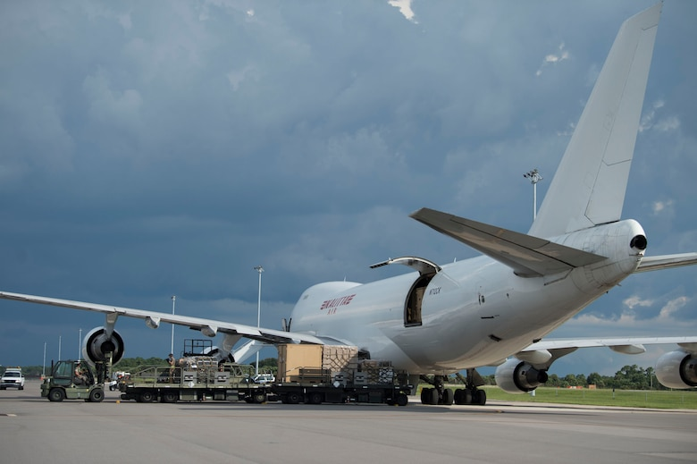 Members of the 6th Logistics Readiness Squadron remove pallets and crates of cargo from a Boeing 747 at MacDill Air Force Base, Fla., July 31, 2019. The team removed 32 increments of cargo which weighed a total of 144,470 pounds of Joint Communications Support Element's deployed equipment. (U.S. Air Force photo by Senior Airman Adam R. Shanks)