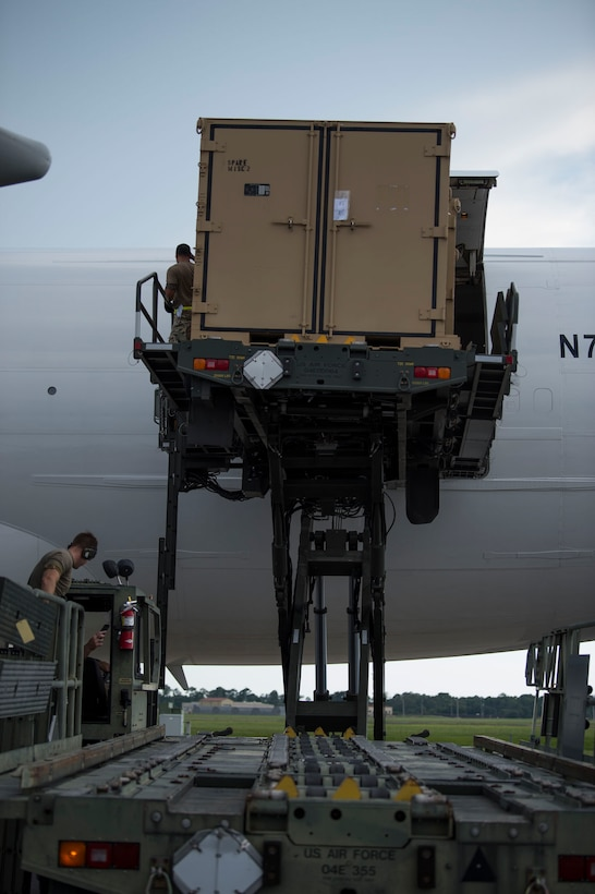 Members of the 6th Logistics Readiness Squadron (LRS) remove cargo from a Boeing 747 aircraft during a cargo movement at MacDill Air Force Base, Fla., July 31, 2019. With 32 increments of cargo weighing 144,470 pounds, this movement equates to 22 percent of total tonnage moved by the 6th LRS in 2019. (U.S. Air Force photo by Senior Airman Adam R. Shanks)